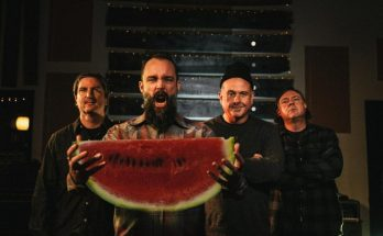 Clutch band photo with Neil Fallon holding a watermelon for some reason.