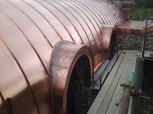 Curved barrelvaulted copper roofs for barn  Metal Roof Ltd