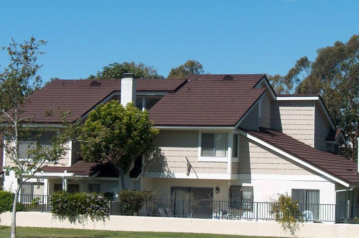 These shake-sided condominiums in Ontario chose a brown steel shingle roof from Metal Roof Outlet.