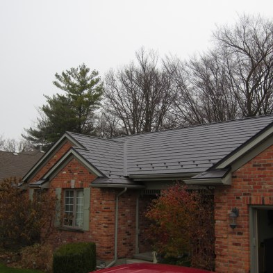 This style of metal roof is Edco Arrowline Shake in the colour Statuary Bronze.