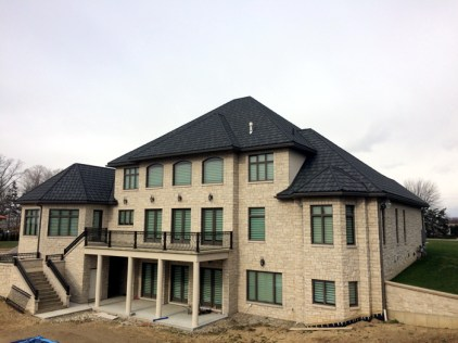 This sprawling, villa-inspired Ontario home wouldn't be complete without Metal Roof Outlet's steel continental tile in a classic Natural Slate style.