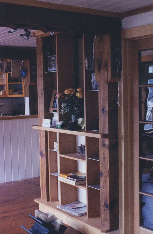 Built in shelving units with recycled spruce beams, steel bridge beams, reclaimed fir stair treads and aluminum plate.
