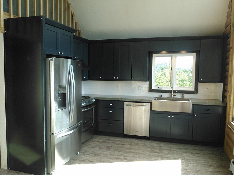 Painted maple cabinets, concrete countertop, steel window trim