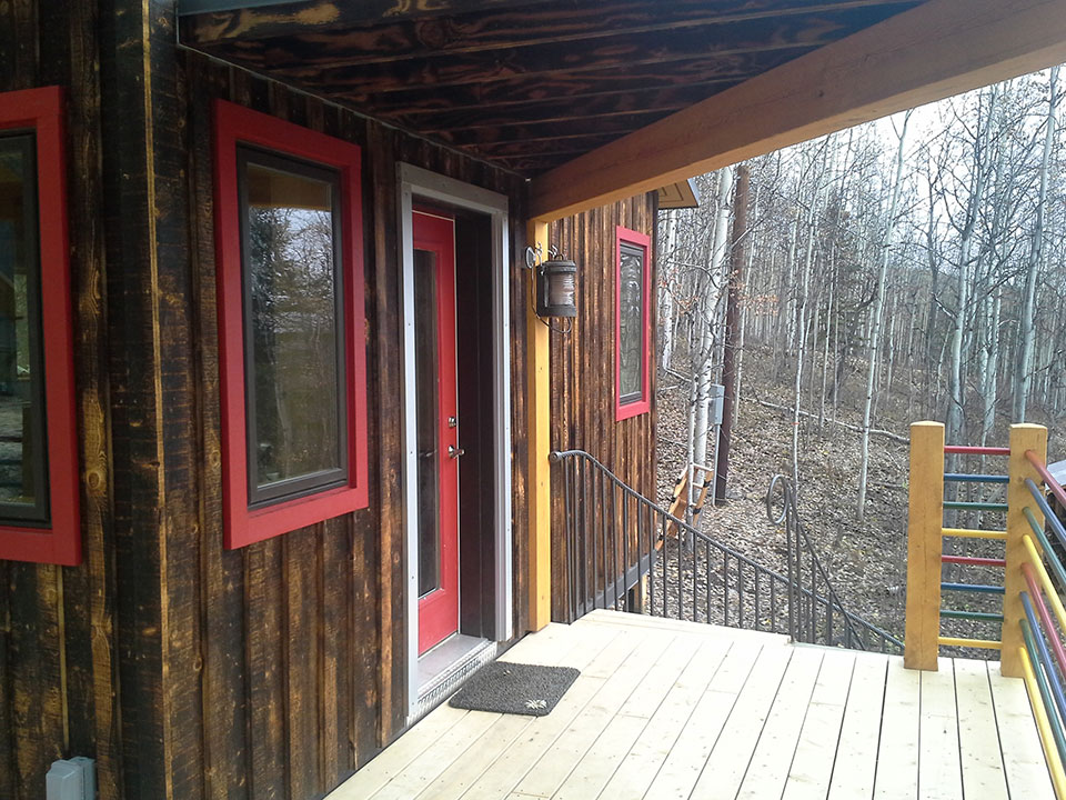 Shou Sugi Ban siding, yellow cedar decking, miscellaneous metal details