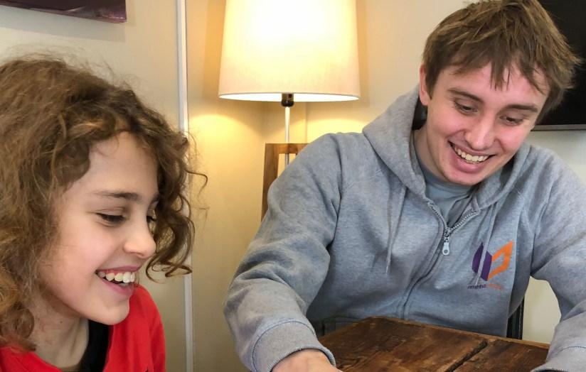 university student tutoring child