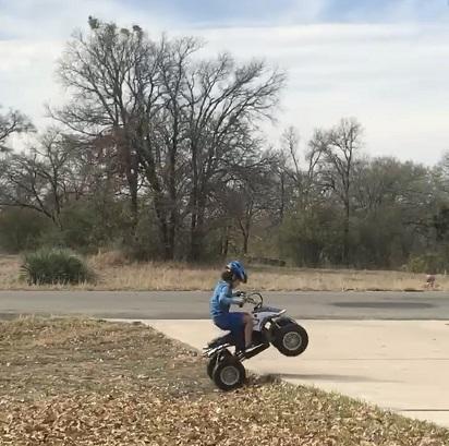four wheeler, four wheeler wheelie, kid on a four wheeler