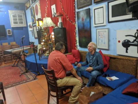 Willie Cosme and Wade Rathke sit in the back of the Poetry Passage in Old San Juan, Puerto Rico.