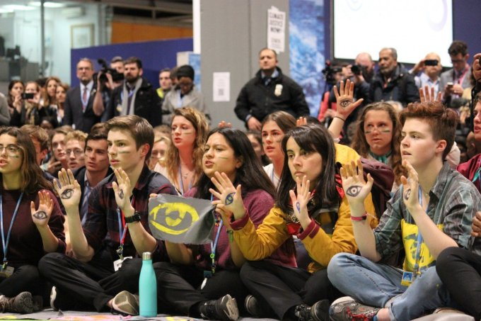 Angela Valenzuela (second from right) at a Fridays for Future sit-in during the final day of the UNFCCC COP25 in Madrid, Spain. Activists painted eyes on their hands to bring attention to the state violence toward civil society groups during the uprisings in Chile. (Photo: Katherine Quaid/WECAN International)