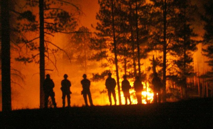 Warm Fire 2006 Firefighters lined up at night. North Kaibab district. 2006. Credit the U.S. Forest Service, Southwestern Region, Kaibab National Forest.