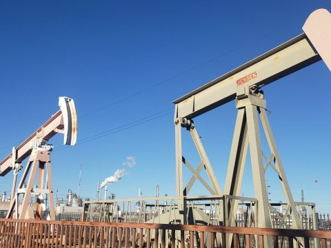 Decommissioned pumpjacks stand on what was once an Atchison, Topeka and Santa Fe Railway platform. (Corbin Hiar / E&E News)
