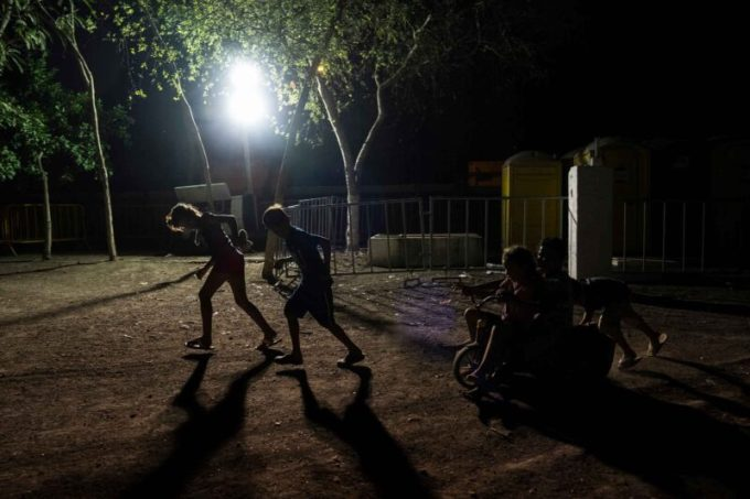 Children seeking asylum play at a migrant camp in Matamoros, Mexico, on Friday. (Verónica G. Cárdenas for The Texas Tribune/ProPublica)