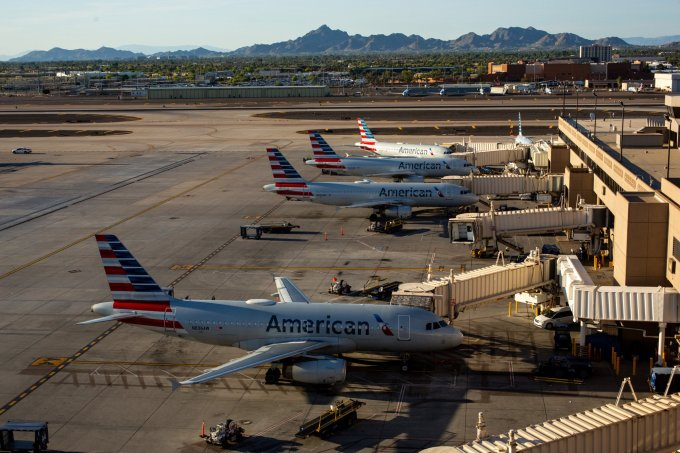 American Airlines planes sit on the tarmac at Phoenix Sky Harbor International Airport on Saturday, April 25, 2020. (Photo by Nicole Neri | AZCIR)