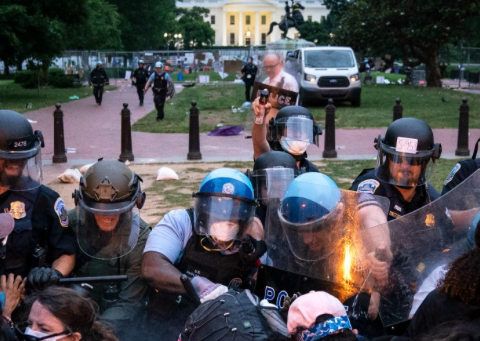 U.S. Park Police forces back protesters using batons and pepper spray after some attempted to pull down the statue of Andrew Jackson in Lafayette Square near the White House on June 22, 2020 in Washington, D.C. (Photo: Tasos Katopodis)