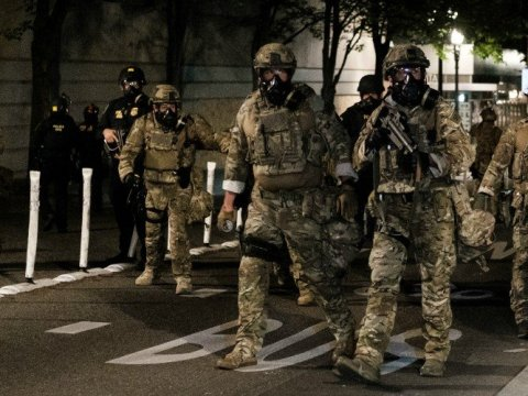 Federal officers prepare to disperse the crowd of protestors outside the Multnomah County Justice Center on July 17, 2020 in Portland, Oregon. (Photo: Mason Trinca/Getty Images)