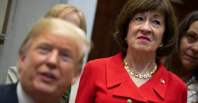 Sen. Susan Collins (R-Maine) stands alongside U.S. President Donald Trump as he signs bills intended to lower prescription drug prices during a ceremony in the Roosevelt Room of the White House in Washington, D.C, October 10, 2018. (Photo: Saul Loeb/AFP via Getty Images)