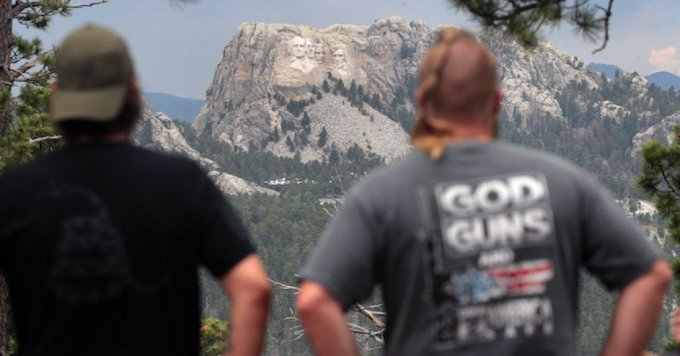 Visitors look at Mount Rushmore National Monument on July 02, 2020 near Keystone, South Dakota. President Donald Trump is expected to visit the monument and speak before the start of a fireworks display on July 3. (Photo: Scott Olson)
