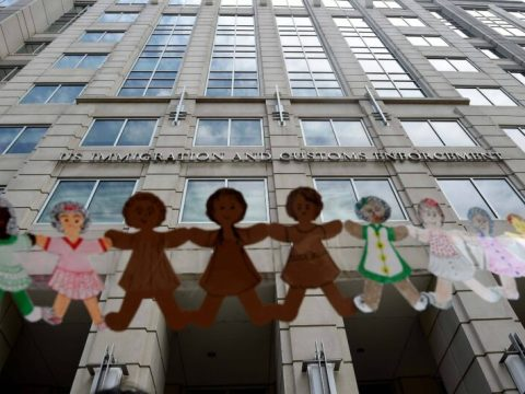 Paper dolls are held by demonstrators protesting outside the Immigration and Customs Enforcement headquarters in Washington on July 17 to demand the release of immigrant families in detention centers at risk during the coronavirus pandemic. (Olivier Douliery/AFP/Getty Images)