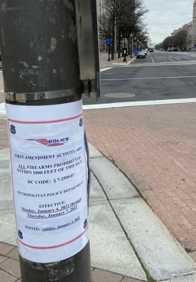 Notice posted on DC telephone pole warning that gun laws will be enforced.