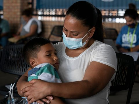 Venezuelan asylum seeker Jhinezka de Arias holds her son Cristhofer at the bus station in Brownsville, Texas, on Feb. 25. Credit: Verónica G. Cárdenas for The Texas Tribune/ProPublica