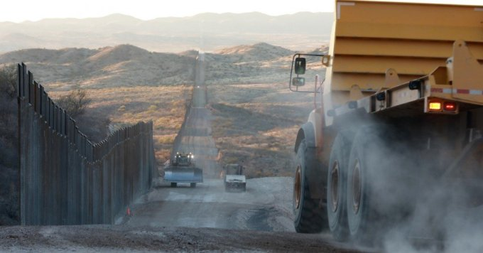 Construction championed by then-President Donald Trump continued on a wall along the U.S.-Mexico border on January 12, 2021 in Sasabe, Arizona. (Photo: Micah Garen/Getty Images)