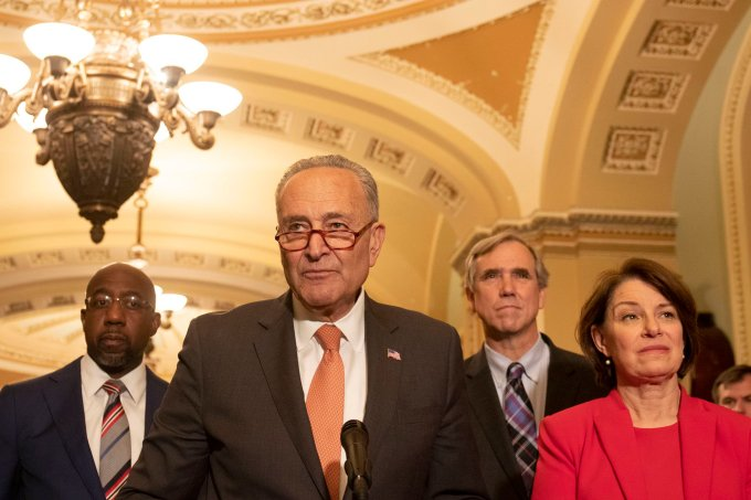 """Senate Majority Leader Chuck Schumer, surrounded Tuesday by other Senate Democrats, challenged Republicans to allow a vote on voting rights legislation, but all 50 GOP senators voted to block a vote. (Photo by <a href=""""https://cronkitenews.azpbs.org/people/brooke-newman/"""" target=""""_blank"""" rel=""""noopener"""">Brooke Newman</a>/Cronkite News)"""