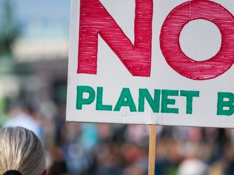 Demonstrators attend a protest demanding climate action on November 18, 2020. (Photo: Getty Images)
