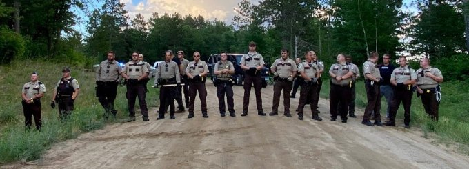 Since June 28, police in Minnesota have blockaded a driveway to an Indigenous camp of water protectors protesting the Line 3 pipeline. (Photo: Giniw Collective)