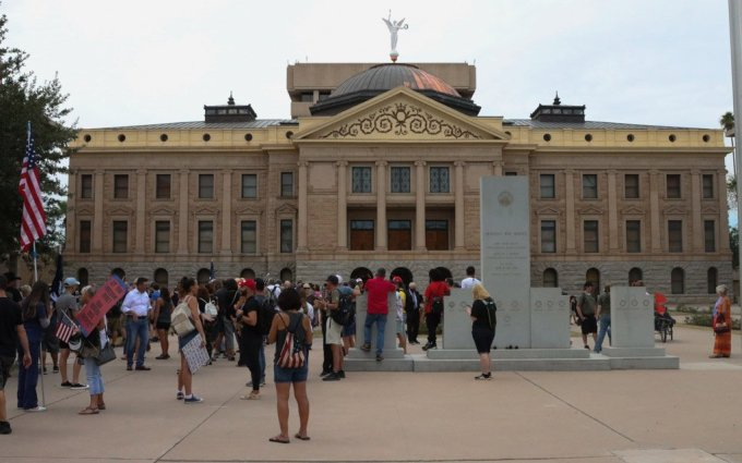 Hundreds gathered outside the Arizona State Capitol Friday, where senators inside received the report from contractors who investigated the Maricopa County elections. (Photo by Sierra Alvarez/Cronkite News)
