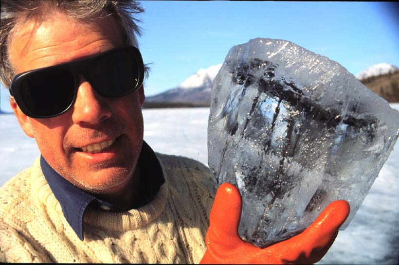 Alan Hildebrand holding a chunk of ice with has within it pieces of the meteorite now known as Tagish Lake, which fell during the winter of 2000 in northern Canada