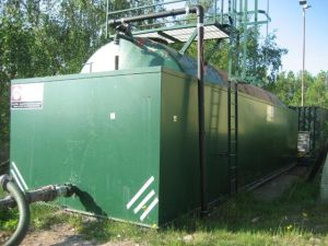 Image of a retrofitted methane stripping leachate storage tank
