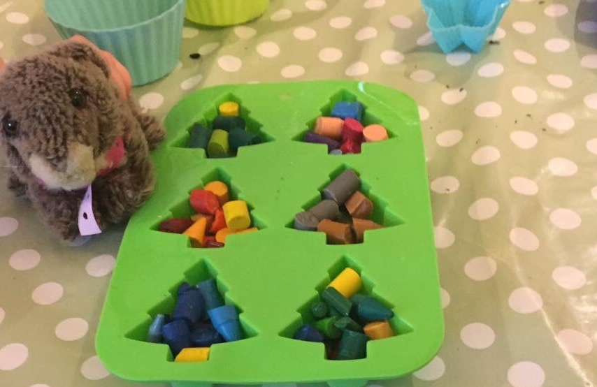 Crayons in silicone moulds before going into the oven