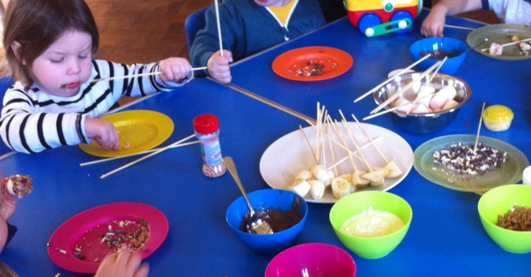 Planning toddler group activities - girl making banana men