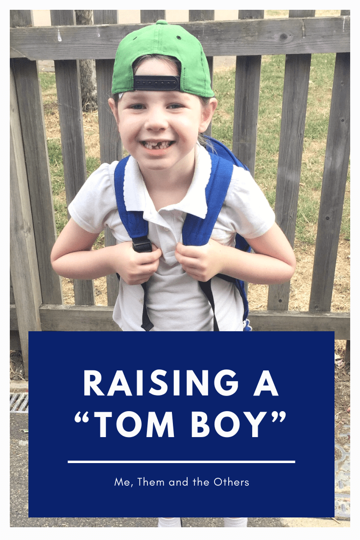 "Raising a ""Tom Boy"" Picture of a little girl in a green cap worn backwards"