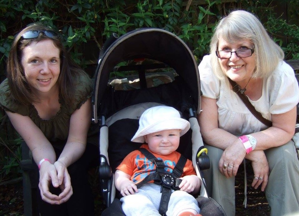 Ways to help with postnatal depression - mum, baby and grandmother in the sun.