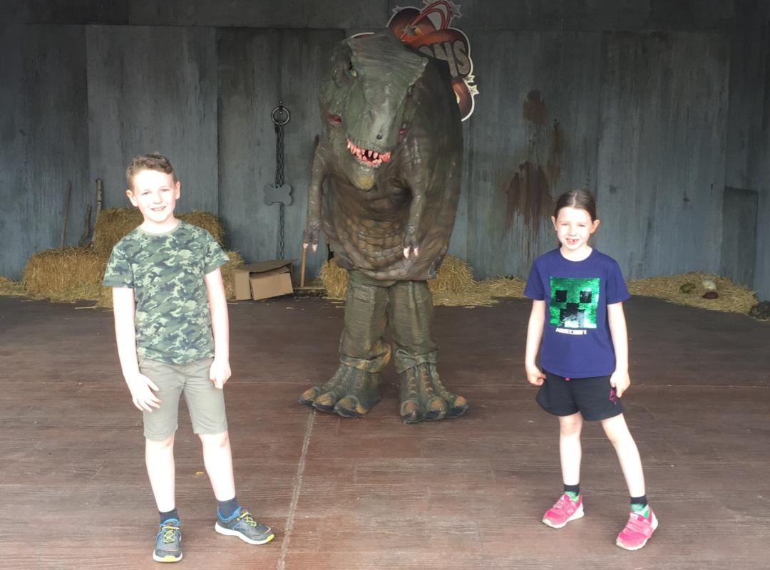 Children with a dinosaur at Paultons Park