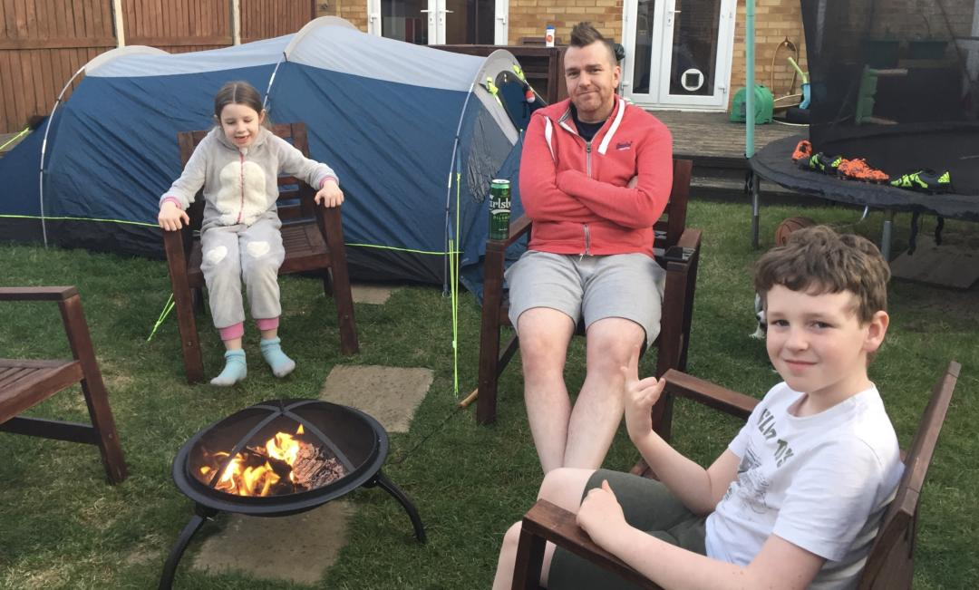 Back garden camping, sitting around the campfire