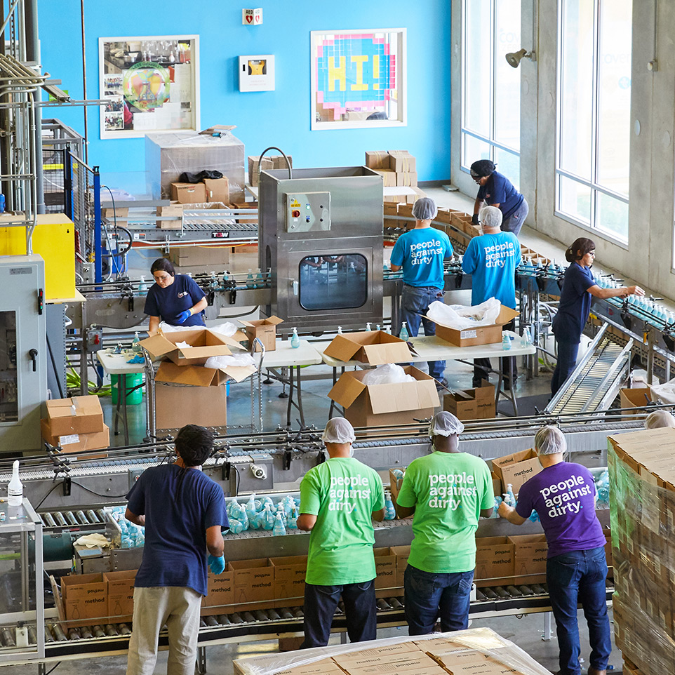 workers at the factory wearing colorful shirts