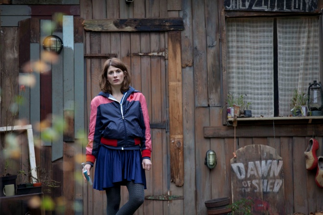 jodie whittaker standing in front of a shed that says dawn of the shed in Adult life skills