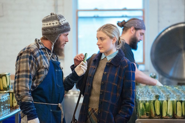 Maggie's Plan Review Travis Fimmel is holding a pick in front of Greta Gerwig in New York