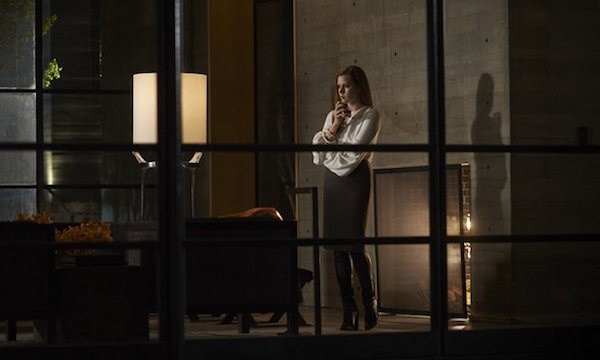 Amy Adams holds a drink in Nocturnal Animals
