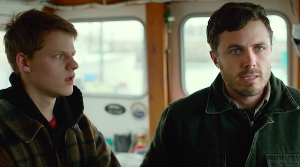 Lucas Hedges looks at Casey Affleck in Manchester By The Sea