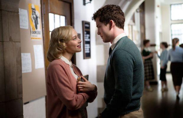 Logan Lerman and Sarah Gadon look at each other in Indignation