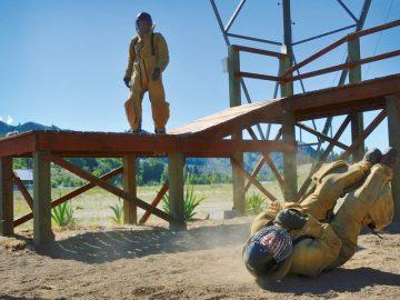 Smokejumper trainees Luke Barrett and Justen Johansen practice parachute landing falls.
