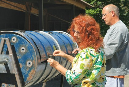 Textile artist Sara Ashford and metal artisan Jerry Merz inspect the latched doors on the barrels. Both artists worked with the students to refine the design and calculate angles and a budget. Photo by Marcy Stamper