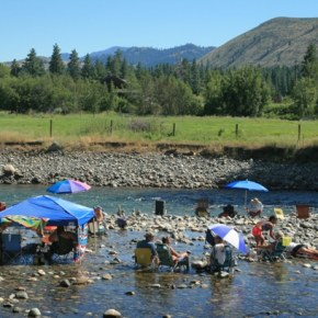 Some fans enjoyed the blues from the coolness of the river. Photo by Marcy Stamper