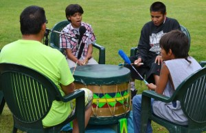Four members of T'tuuxshiipa Walptaykthlama (The Spring Creek Singers) – Jim Roberts, Leighton Andrews, Jaystin Stenger and Tukoma Marchand - sang and drummed. Photo by Laurelle Walsh
