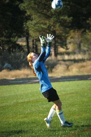 Senior goalkeeper Hannah Hafsos spent part of practice earlier this week fielding shots on goal. Photo by Mike Maltais