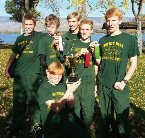 File photo: Members of the Liberty Bell High School varsity boys' cross-country team pose with ribbons and the first-place trophy won at the Oroville Invitational earlier this season. Standing from left are Josiah Klemmeck, Morgan Ott, Liam Daily, Ben Klemmeck and Willy Duguay. Holding the trophy is Carter Dornfeld. Not pictured is Logan Szafas. Photo courtesy of Jennifer Duguay