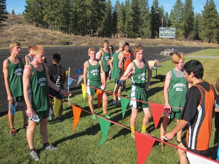 Members of the Liberty Bell cross-country team greet other finishers.