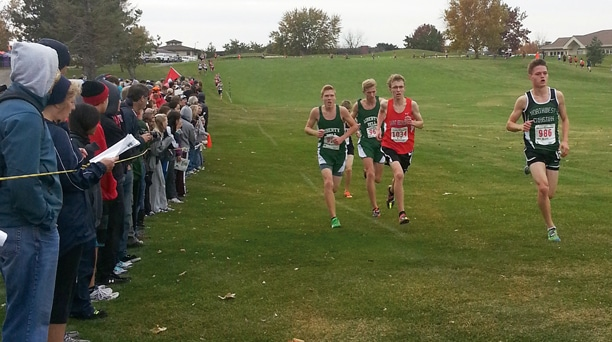 Liberty Bell runners Ben Klemmeck and Liam Daily – from left, in the middle of the photo – stalk the frontrunners at the 2.3-mile mark of last weekend's state cross-country championships in Pasco. Daily finished sixth and Klemmeck seventh to lead the Lions to a fifth-place finish in team standings. Photo courtesy of Jennifer Duguay